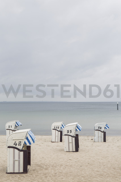 Germany, Timmendorf Beach with hooded beach chairs - ASCF000573