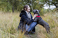Woman with her dog in nature - MAUF000501