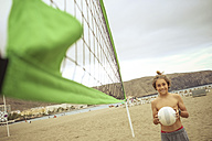 Spain, Tenerife, young boy with beach volleyball - SIPF000367