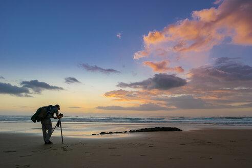 Portugal, Algarve, Aljezur, beach in the evening, photographer at atlantic coast - ASAF000017