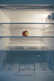 Nearly empty fridge with a seared bitten apple - IPF000289