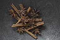Cinnamon sticks and star anise on metal plate - ASF005889