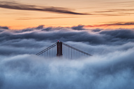 USA, San Francisco, Golden Gate bridge in fog at sunset - STCF000214