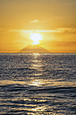 Italy, Sicily, Aeolian Islands, View to Isola Stromboli at sunset - CSTF001053