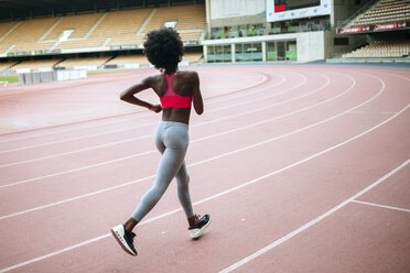Young black athlete running in stadium - KIJF000389