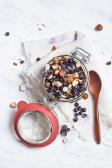 Preserving jar of overnight oats with pineapple, coconut, chia pudding, hazelnuts and berries - SBDF002799