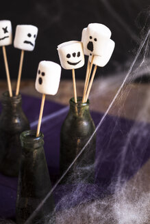 Halloween marshmallows with ghost faces on skewers - SBDF002805