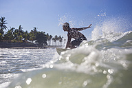 Indonesia, Bali, surfer on wave - KNTF000277