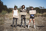 Three hippies holding 'I love you' signs in the nature - GIOF000903