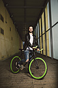 Young man on fixie bike - RAEF001114