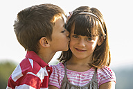 Little boy kissing his girlfriend - ZOCF000110
