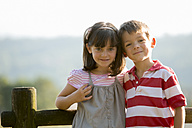 Portrait of happy little boy and girl face to face - ZOCF000113