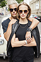 Portrait of cool young couple wearing sunglasses - CHAF001665
