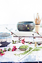 Matcha tea in bowl, with match powder, spoon and chasen and pink flowers - SBDF002858