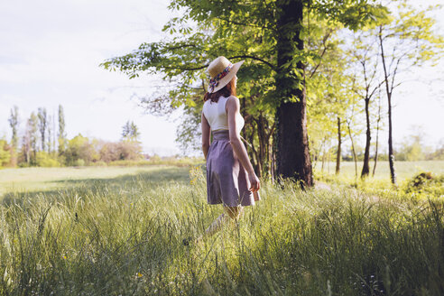 Young woman on a meadow in spring - GIOF000918