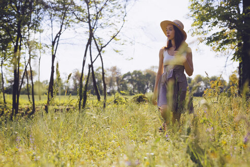 Young woman on a meadow in spring - GIOF000921
