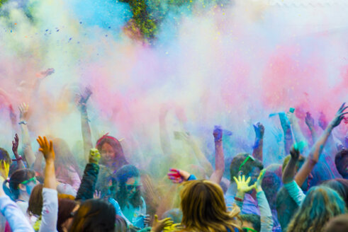 Spain, people celebrating Holi Festival - SKC000089