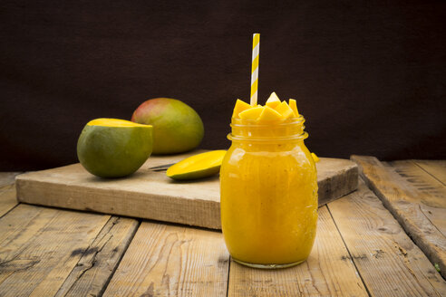 Glass of mango smoothie garnished with diced mango - LVF004837