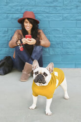 Portrait of French bulldog wearing yellow knit pullover - RTBF000171