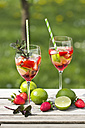 Glasses with ice, strawberry, lime, grenadine and prosecco - YFF000541