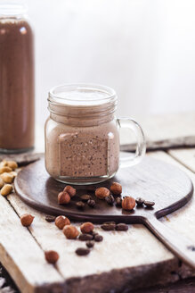 Glass of smoothie with coffee, roasted hazelnuts and chia seeds - SBDF002885