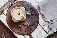 Glass of smoothie with coffee, roasted hazelnuts and chia seeds - SBDF002891