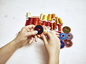 Hand with sewing utensils - DISF002468