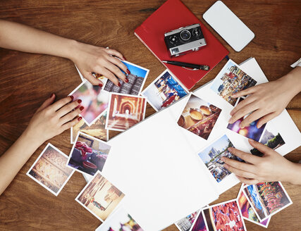 Hands sorting photo prints - DISF002483