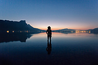 Austria, Lake Mondsee, Rear view of nude man standing in water - WV000753