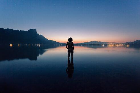 Austria, Lake Mondsee, Rear view of nude man standing in water - WV000753
