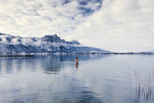 Austria, Lake Mondsee, Rear view of nude man standing in water - WV000759