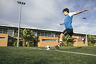 Football player kicking a ball - ABZF000446