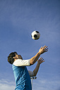 Football player with ball in the air - ABZF000461