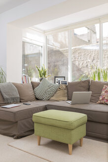 Couch with laptop in a living room - BOYF000337
