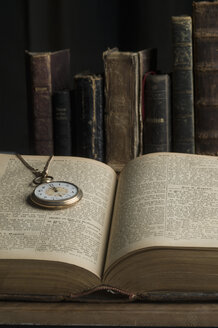 Opened book with old pocket watch - CRF002752