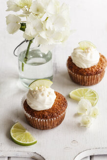 Two lime cup cakes with cream cheese topping - EVGF002946