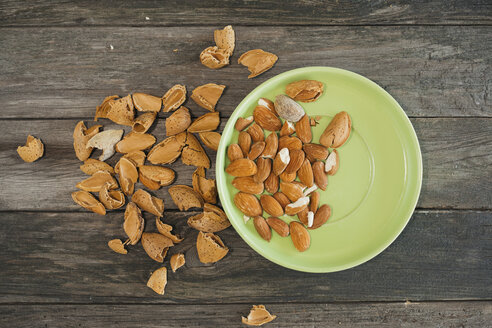 Almonds, green plate on wood - JPF000135