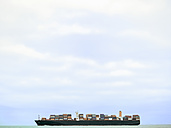 Germany, near Cuxhaven, North Sea, loaded container ship - KRPF001746