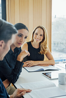 Smiling businesswoman in a meeting - CHAF001705
