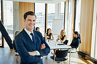 Portrait of confident businessman in a meeting - CHAF001711