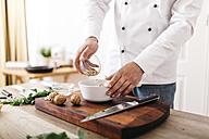 Chef preparing stuffing for ravioli, mixing ingredients - JRFF000642