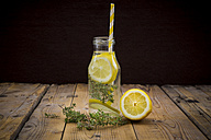 Glass bottle of table water flavored with lemon and thyme - LVF004859