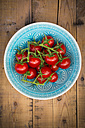 Tomatoes in turquoise bowl - LVF004865