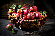 Wickerbasket of organic red apples - MAEF011660
