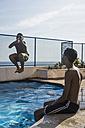 Two boys having fun in swimming pool - MAUF000556