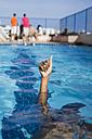 Hand of a boy inside swimming pool - MAUF000559
