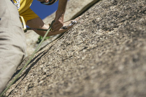 Climber clipping a quickdraw - ABZF000484