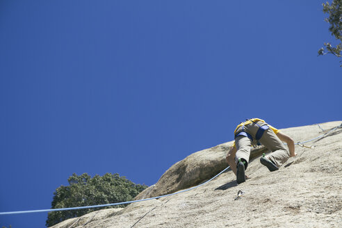 Man climbing in a granite wall - ABZF000505