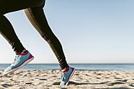 Woman running on the beach - JRFF000676