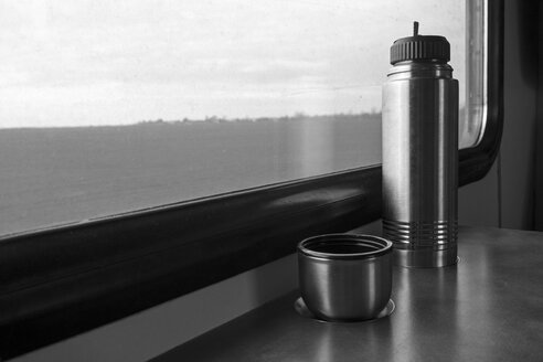 Thermos flask on table in a train - MELF000111